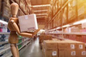 Online Delivery Concepts From online ordering: The transporting of items or merchandise from warehouse place to customers. Online Shopping transport carriage. Dummy holding paper cartons for delivery.
